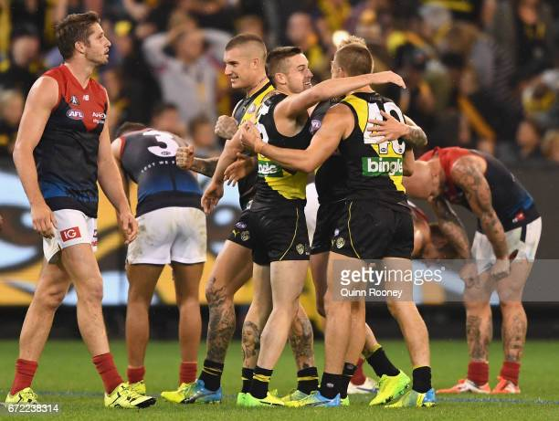 Jayden Short Brandon Ellis and Dan Butler of the Tigers celebrate winning the round five AFL match between the Richmond Tigers and the Melbourne...