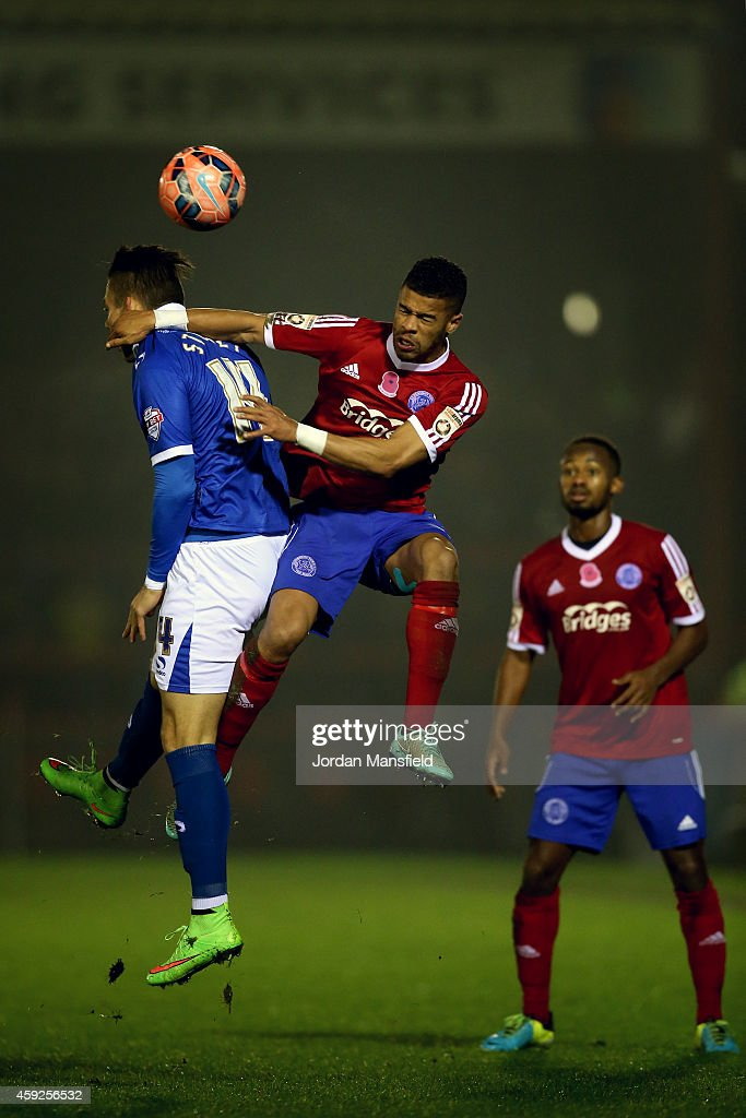 Jaydon Gibbs of Aldershot and Miles Storey of Portsmouth challenge for a header during the FA Cup First Round Replay match between Aldershot Town and...