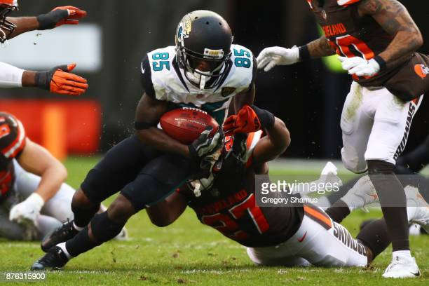 Jaydon Mickens of the Jacksonville Jaguars is tackled by Matt Dayes of the Cleveland Browns in the first half at FirstEnergy Stadium on November 19...