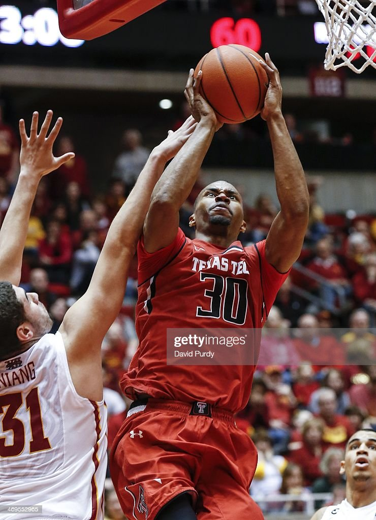 Jaye Crockett #30 of the Texas Tech Red Raiders puts up a shot as Georges Niang #31 of the Iowa State Cyclones defends in the second half of play at Hilton Coliseum on February 15, 2014 in Ames, Iowa. Iowa State defeated Texas Tech 70-64.