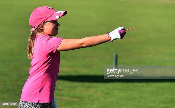 Jayla Kucy lines up her drive during the driving segment during Drive Chip and Putt regional qualifying at Chambers Bay on September 12 2015 in...