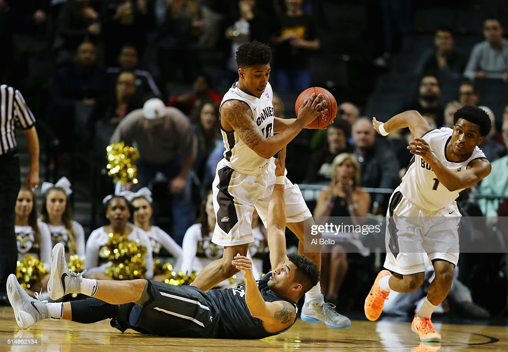 Jaylen Adams of the St Bonaventure Bonnies grabs the ball against Jack Gibbs of the Davidson Wildcats during the Quarterfinals of the Atlantic 10...