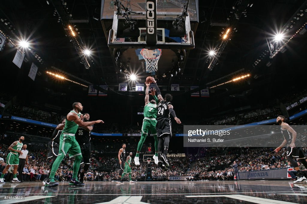 Jaylen Brown #7 of the Boston Celtics drives to the basket and shoots the ball over Rondae Hollis-Jefferson #24 of the Brooklyn Nets on November 14, 2017 at Barclays Center in Brooklyn, New York.