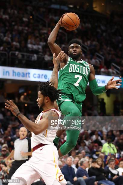 Jaylen Brown of the Boston Celtics gets to the basket next to Derrick Rose of the Cleveland Cavaliers during the second half at Quicken Loans Arena...