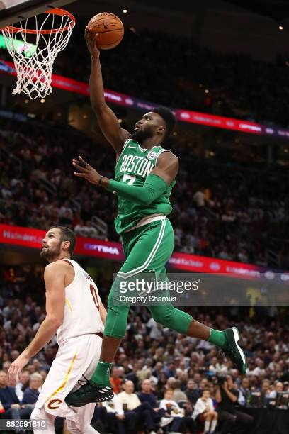 Jaylen Brown of the Boston Celtics gets to the basket next to Kevin Love of the Cleveland Cavaliers during the second half at Quicken Loans Arena on...