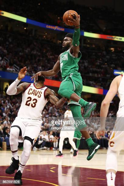 Jaylen Brown of the Boston Celtics gets to the basket next to LeBron James of the Cleveland Cavaliers during the second half at Quicken Loans Arena...