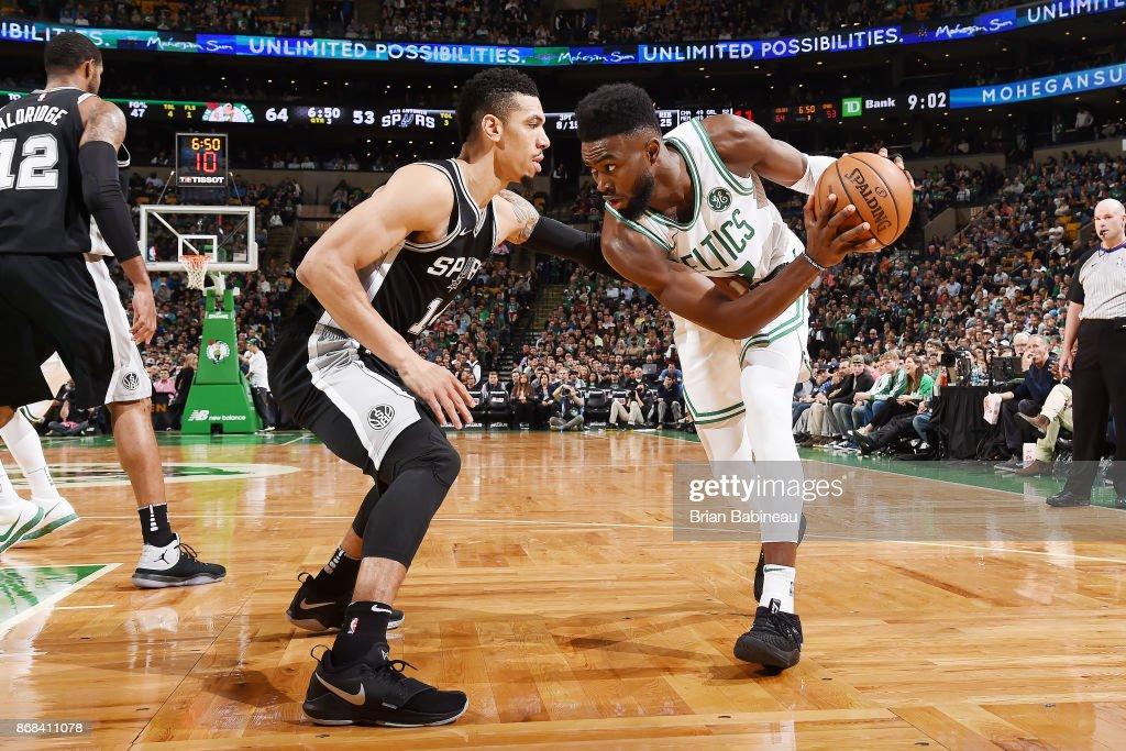 Jaylen Brown #7 of the Boston Celtics handles the ball against Danny Green #14 of the San Antonio Spurs on October 30, 2017 at the TD Garden in Boston, Massachusetts.