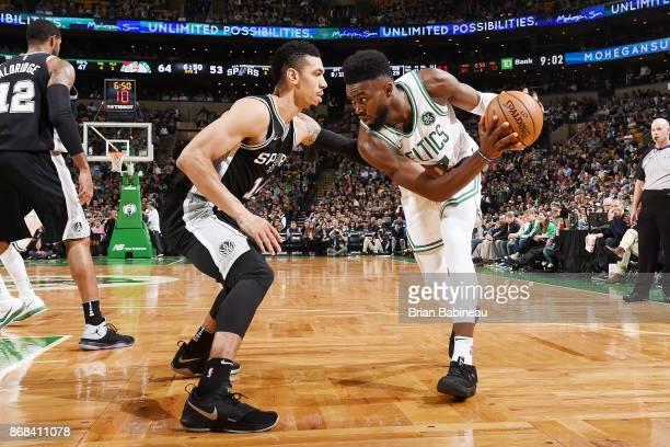 Jaylen Brown of the Boston Celtics handles the ball against Danny Green of the San Antonio Spurs on October 30 2017 at the TD Garden in Boston...