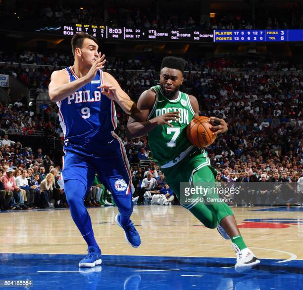 Jaylen Brown of the Boston Celtics handles the ball against Dario Saric of the Philadelphia 76ers during the game on October 20 2017 at Wells Fargo...