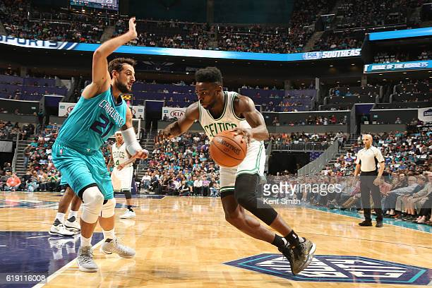 Jaylen Brown of the Boston Celtics handles the ball against Marco Belinelli of the Charlotte Hornets during a game on October 29 2016 at the Spectrum...
