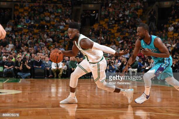 Jaylen Brown of the Boston Celtics handles the ball against the Charlotte Hornets during a preseason game on October 2 2017 at the TD Garden in...
