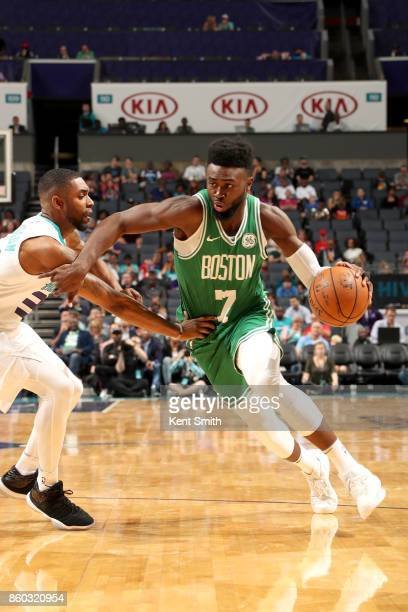 Jaylen Brown of the Boston Celtics handles the ball against the Charlotte Hornets on October 11 2017 at Spectrum Center in Charlotte North Carolina...