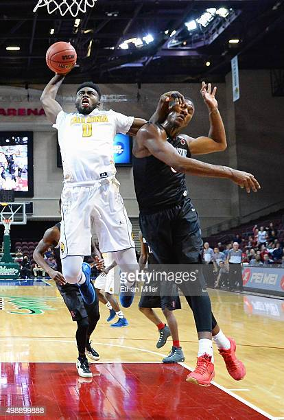 Jaylen Brown of the California Golden Bears drives to thebasket against Skylar Spencer of the San Diego State Aztecs during the 2015 Continental Tire...