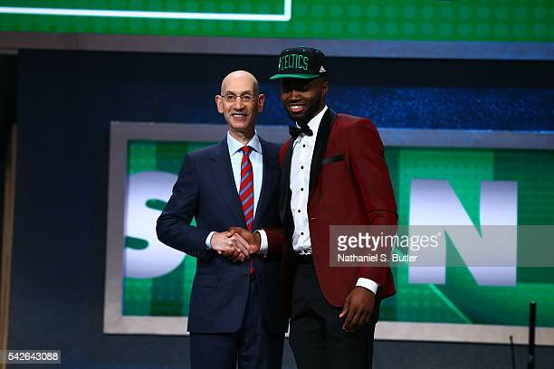 Jaylen Brown shakes hands with NBA Commissioner Adam Silver after being selected number three overall by the Boston Celtics during the 2016 NBA Draft...