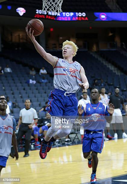 Jaylen Fisher in white goes for a layup during the NBPA Top 100 Camp on June 18 2015 at John Paul Jones Arena in Charlottesville Virginia