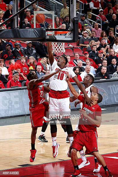 Jaylen Johnson of the Louisville Cardinals drives to the basket against the Jacksonville State Gamecocks during the game at KFC Yum Center on...