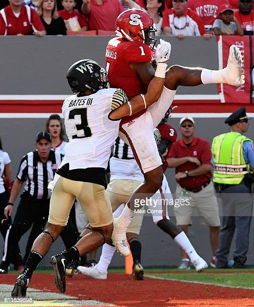 Jaylen Samuels of the NC State Wolfpack makes a leaping touchdown reception against the Wake Forest Demon Deacons at CarterFinley Stadium on October...