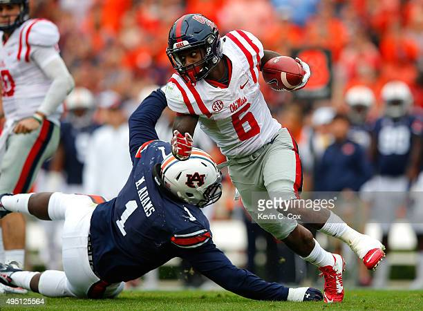 Jaylen Walton of the Mississippi Rebels breaks a tackle by Montravius Adams of the Auburn Tigers at JordanHare Stadium on October 31 2015 in Auburn...