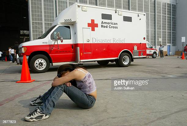 Jaylene Smith of Crestline California rests in front of an American Red Cross truck at an evacuation at the San Bernardino Airport shelter October 29...