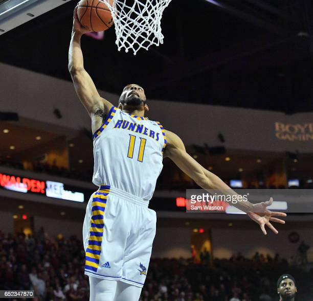 Jaylin Airington of the Cal State Bakersfield Roadrunners goes up for a dunk against the New Mexico State Aggies during the championship game of the...