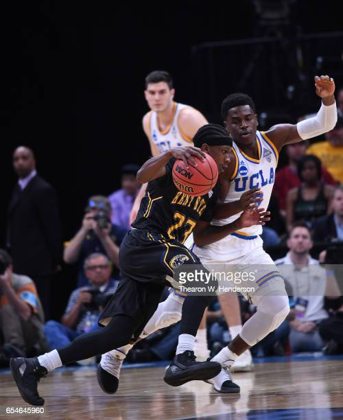 Jaylin Walker of the Kent State Golden Flashes is defended by Aaron Holiday of the UCLA Bruins during the first round of the 2017 NCAA Men's...