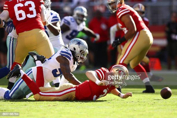 Jaylon Smith of the Dallas Cowboys strips the ball from CJ Beathard of the San Francisco 49ers during their NFL game at Levi's Stadium on October 22...