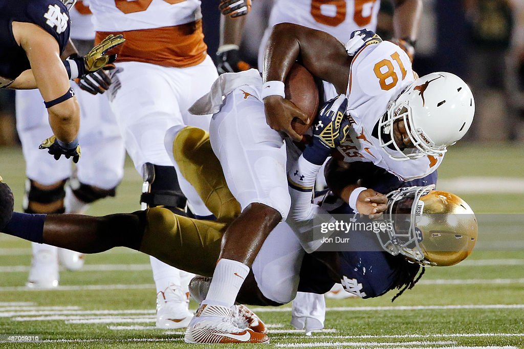 Jaylon Smith of the Notre Dame Fighting Irish sacks Tyrone Swoopes of the Texas Longhorns during the second quarter at Notre Dame Stadium on...