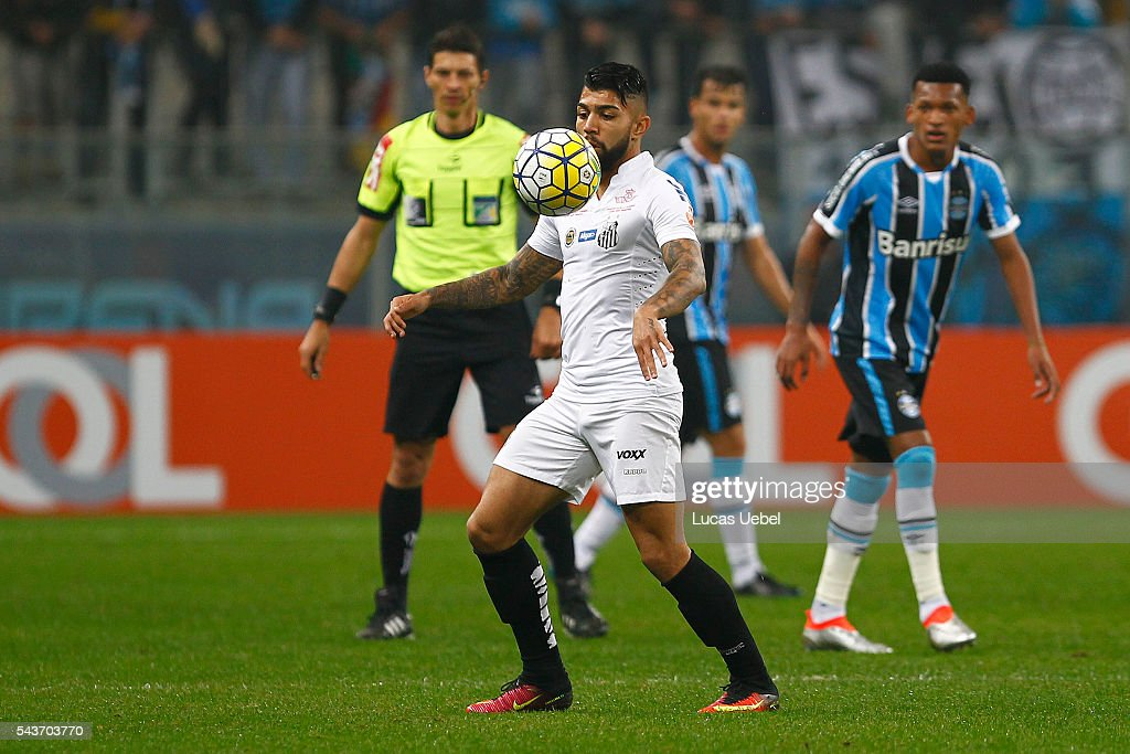Jaylson of Gremio battles for the ball against Gabriel of Santos during the match Gremio v Santos as part of Brasileirao Series A 2016, at Arena do Gremio on June 03, 2015 in Porto Alegre, Brazil.