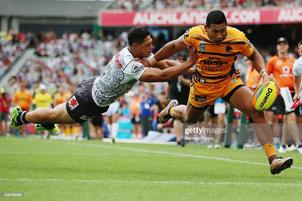 Jaymayne Isaako of the Brisbane Broncos dives over to score a try during the 2016 Auckland Nines match between the New Zealand Warriors and the Brisbane Broncos at Eden Park on February 7, 2016 in Auckland, New Zealand.