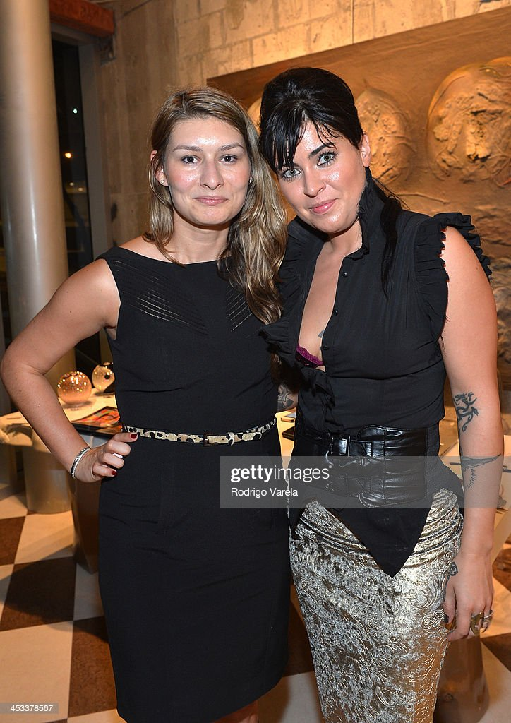 Jayme Clemente and Charity Von Guinness attend the Roman Kriheli Un:veiled Exhibit At Avant Gallery, Featuring The Unveiling Of 'The Most Beautiful Woman In The World' Painting at Epic Hotel on December 3, 2013 in Miami, Florida.