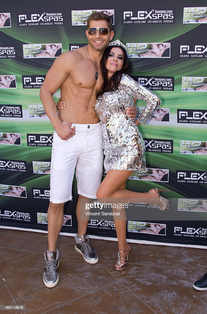 Jaymes Vaughan and TV personality Adriana De Moura attend the SPLASH pool party during Jeffrey Sanker Presents White Party Palm Springs 2013 - Day 2 at the Renaissance hotel on March 30, 2013 in Palm Springs, California.