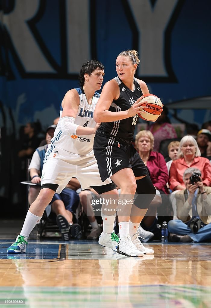 Jayne Appel #32 of the San Antonio Silver Stars backs down Janel McCarville #4 of the Minnesota Lynx during the WNBA game on June 11, 2013 at Target Center in Minneapolis, Minnesota.