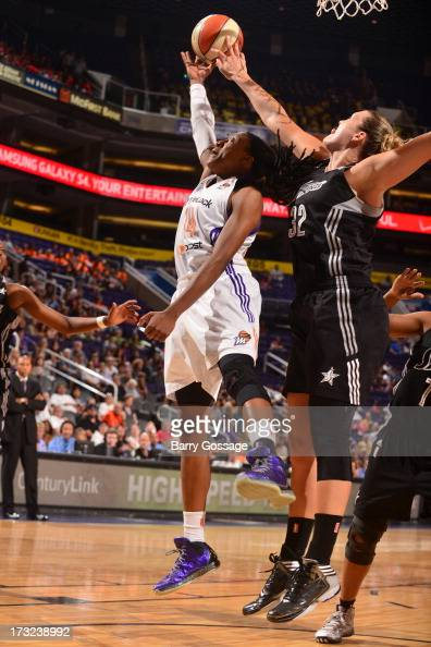 Jayne Appel of the San Antonio Silver Stars blocks a shoot of Alexis Hornbuckle of the Phoenix Mercury on July 10 2013 at US Airways Center in...