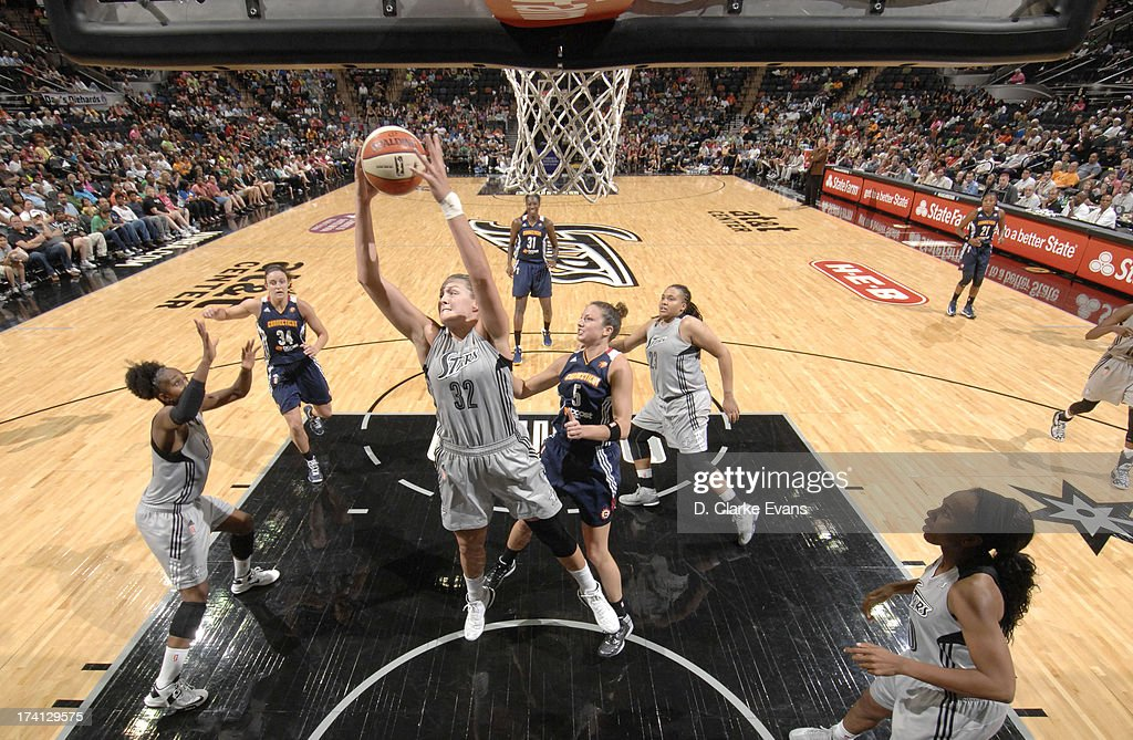 Jayne Appel #32 of the San Antonio Silver Stars pulls down one of her 18 rebounds during the game against Kelsey Griffin #5 of the Connecticut Sun at the AT&T Center on July 20, 2013 in San Antonio, Texas.