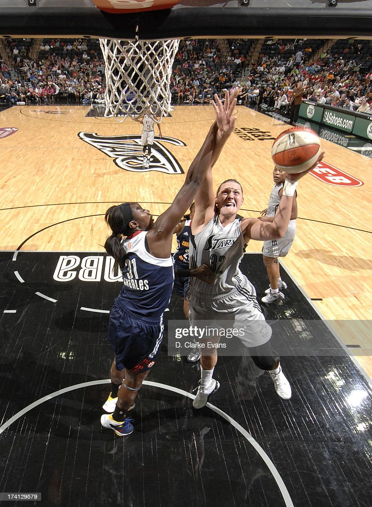 Jayne Appel #32 of the San Antonio Silver Stars shoots against Tina Charles #31 of the Connecticut Sun at the AT&T Center on July 20, 2013 in San Antonio, Texas.