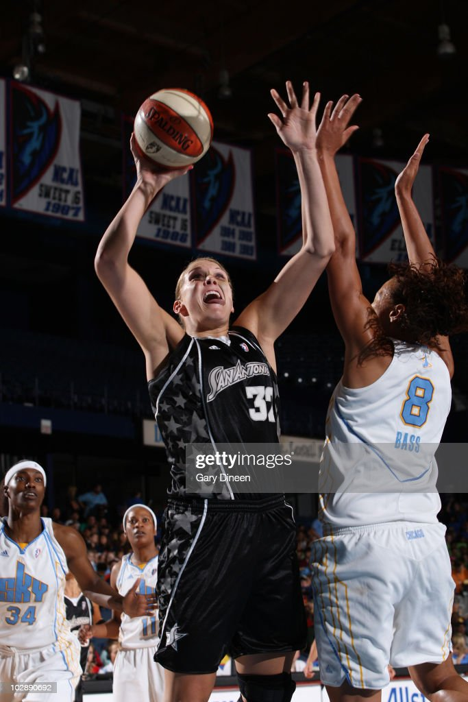 Jayne Appel of the San Antonio Silver Stars shoots over Mistie Bass of the Chicago Sky during the WNBA game on July 14 2010 at the AllState Arena in...