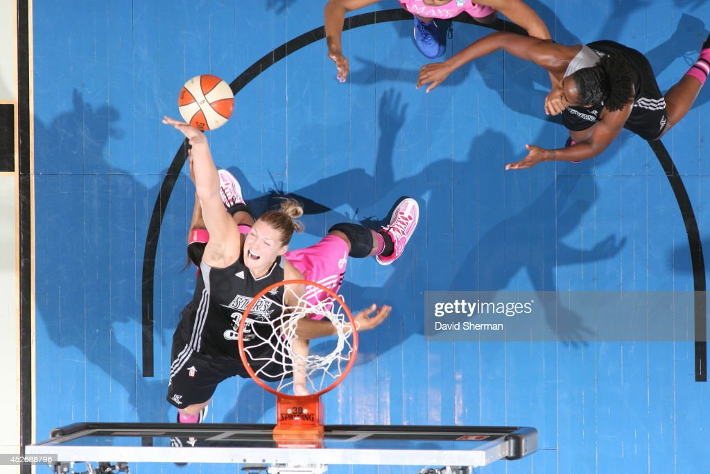 Jayne Appel #32 of the San Antonio Stars and <a gi-track='captionPersonalityLinkClicked' href=/galleries/search?phrase=Maya+Moore+-+Basketball+Player&family=editorial&specificpeople=4215914 ng-click='$event.stopPropagation()'>Maya Moore</a> #23 of the Minnesota Lynx go for the ball during the WNBA game on July 25, 2014 at Target Center in Minneapolis, Minnesota.