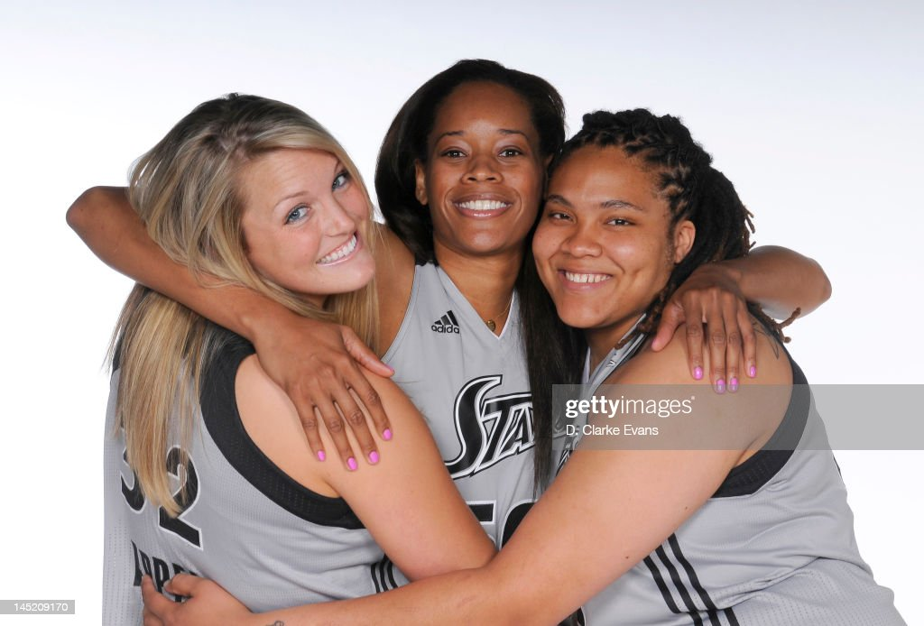 Jayne Appel #32, Tangela Smith #50 and Danielle Adams #23 of the San Antonio Silver Stars pose for a portrait during WNBA Media Day at the AT&T Center on May 16, 2012 in San Antonio, Texas.