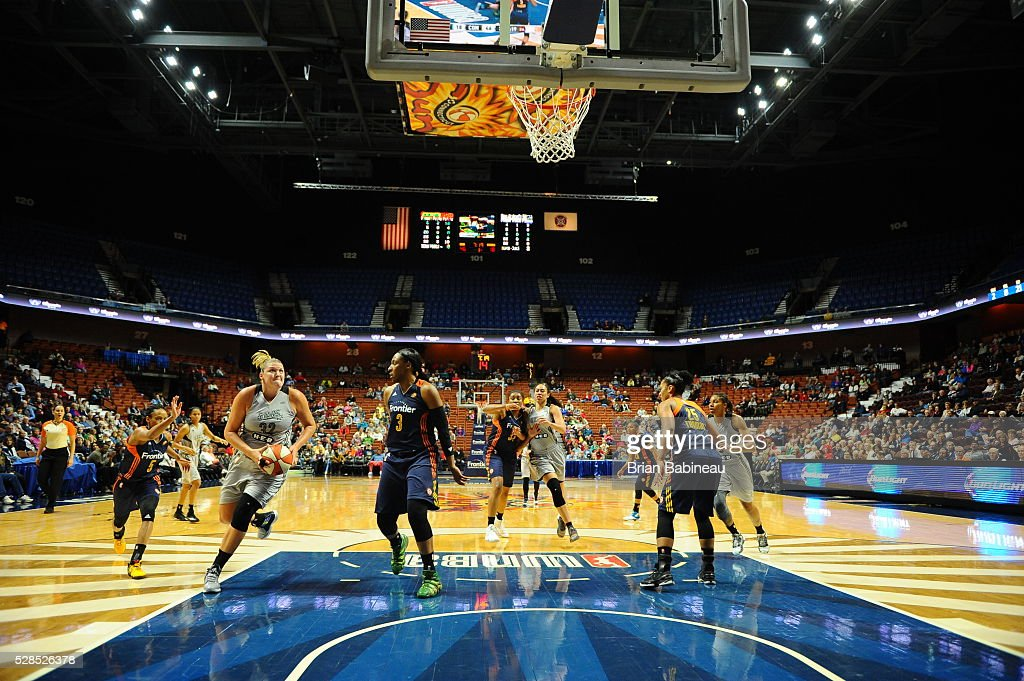 Jayne Appel-Marinelli #32 of the San Antonio Stars drives to the basket against the Connecticut Sun in a WNBA preseason game on May 5, 2016 at the Mohegan Sun Arena in Uncasville, Connecticut.