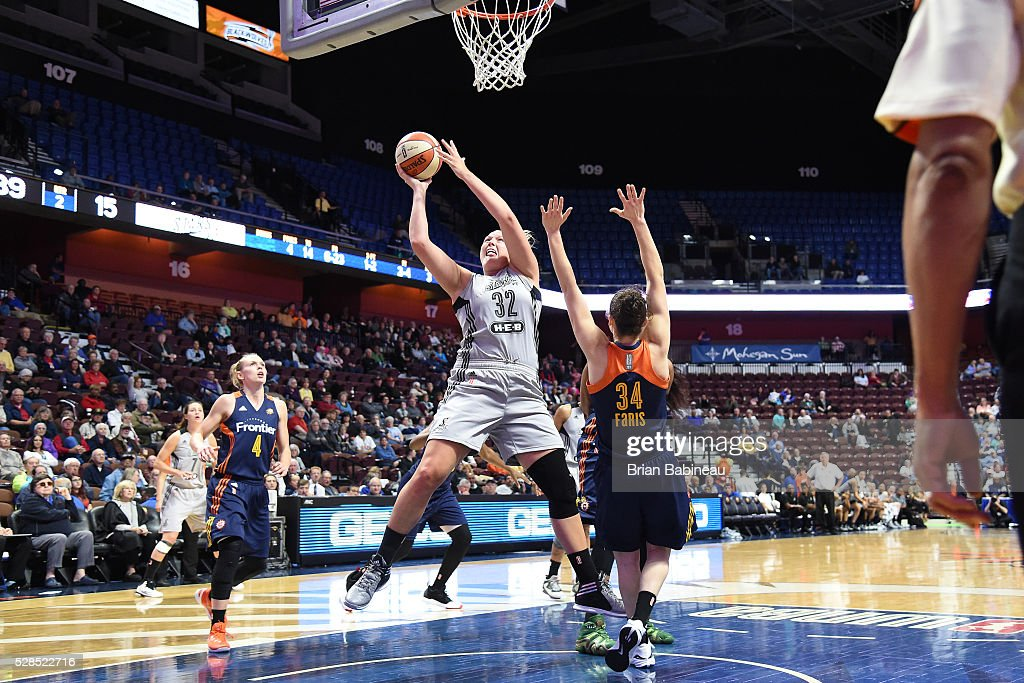 Jayne Appel-Marinelli #32 of the San Antonio Stars shoots the ball against the Connecticut Sun in a WNBA preseason game on May 5, 2016 at the Mohegan Sun Arena in Uncasville, Connecticut.