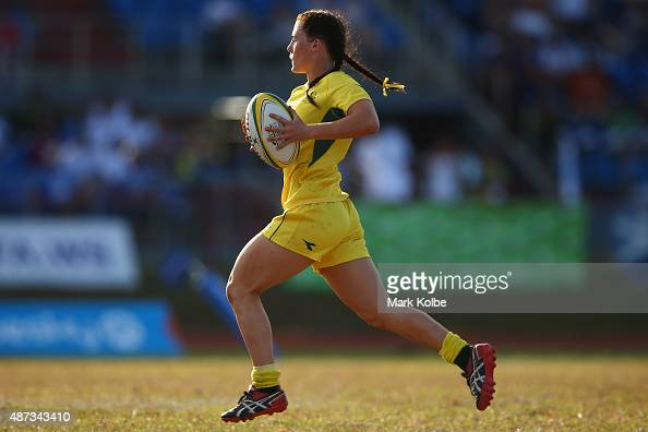 Jayne Fressard of Australia breaks away to score a try during the girls match between Australia and the Cook Islands in the rugby sevens competition...