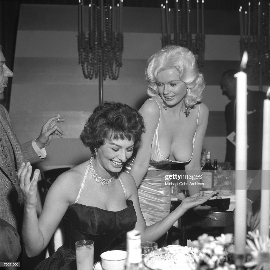 <a gi-track='captionPersonalityLinkClicked' href=/galleries/search?phrase=Jayne+Mansfield&family=editorial&specificpeople=91204 ng-click='$event.stopPropagation()'>Jayne Mansfield</a> tries to steal the show in a very low cut dress at a party thrown by 20th Century-Fox for <a gi-track='captionPersonalityLinkClicked' href=/galleries/search?phrase=Sophia+Loren&family=editorial&specificpeople=94097 ng-click='$event.stopPropagation()'>Sophia Loren</a> on April 12, 1957 in Los Angeles California.