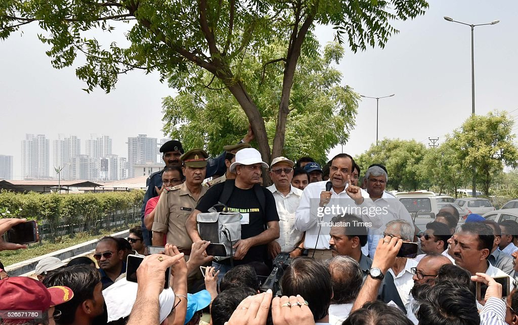 Jaypee Group Executive Chairman and CEO Manoj Gaur greets agitating home buyers as they protesting against delayed deliveries of purchased apartments outside the administrative office of Jaypee Wish Town Integrated City in Sector 128, on April 30, 2016 in Noida, India.