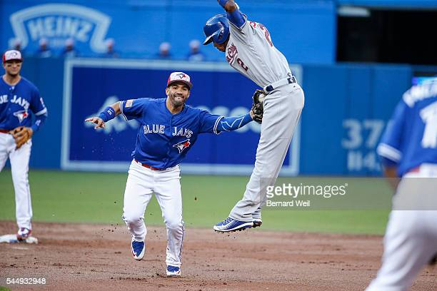 BURLINGTON ON JULY 4 Jays' Devon Travis makes the tag on Royals' Alcides Escobar in the 3rd inning as The Toronto Blue Jays hosted the Baltimore...