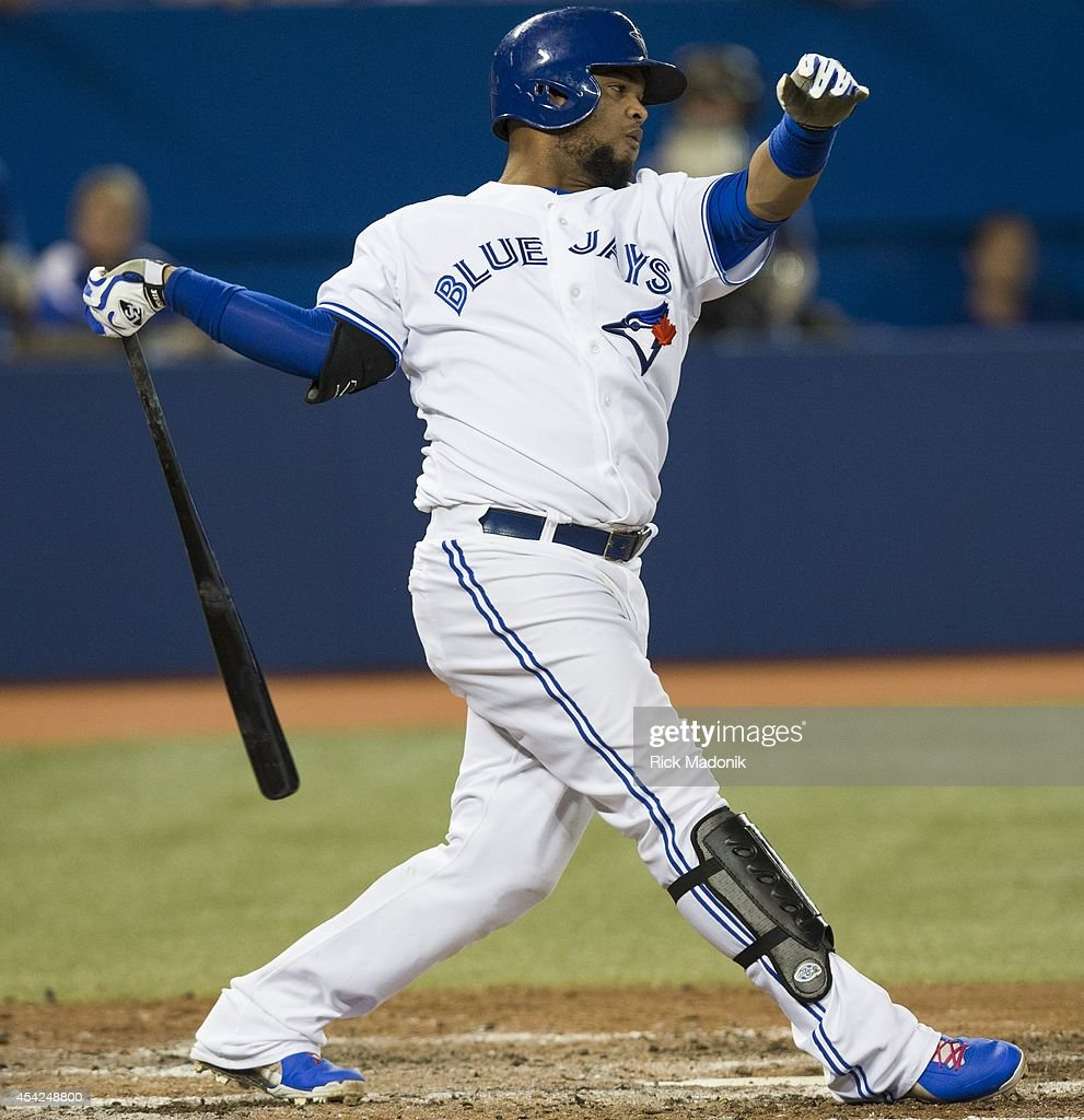 TORONTO - AUGUST 26 - Jays Juan Francisco gets turned around on his follow through. Toronto Blue Jays Vs Boston Red Sox during MLB action at Rogers Centre on August 26, 2014.