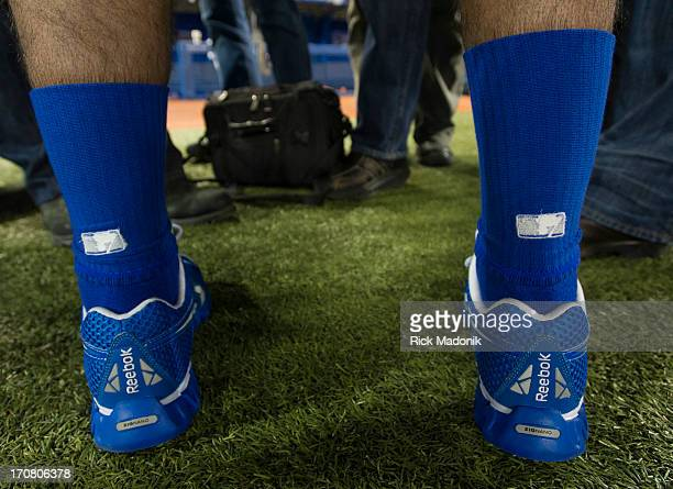 130105 TORONTO ONTARIO Jay's outfielder and resident slugger Jose Bautista's socks aren't quite right with the MLB insignia upside down and backwards...