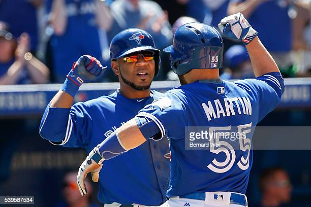 TORONTO ON JUNE 12 Jays' Russell Martin celebrates with Edwin Encarnacion after hitting a three run homer with Encarnacion and Michael Saunders also...