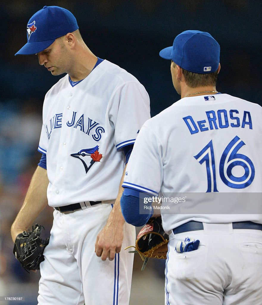 TORONTO ON AUGUST 27 Jays starter JA Happ is done for the night and just waits for Manager John Gibbons Toronto Blue Jays host New York Yankees at...