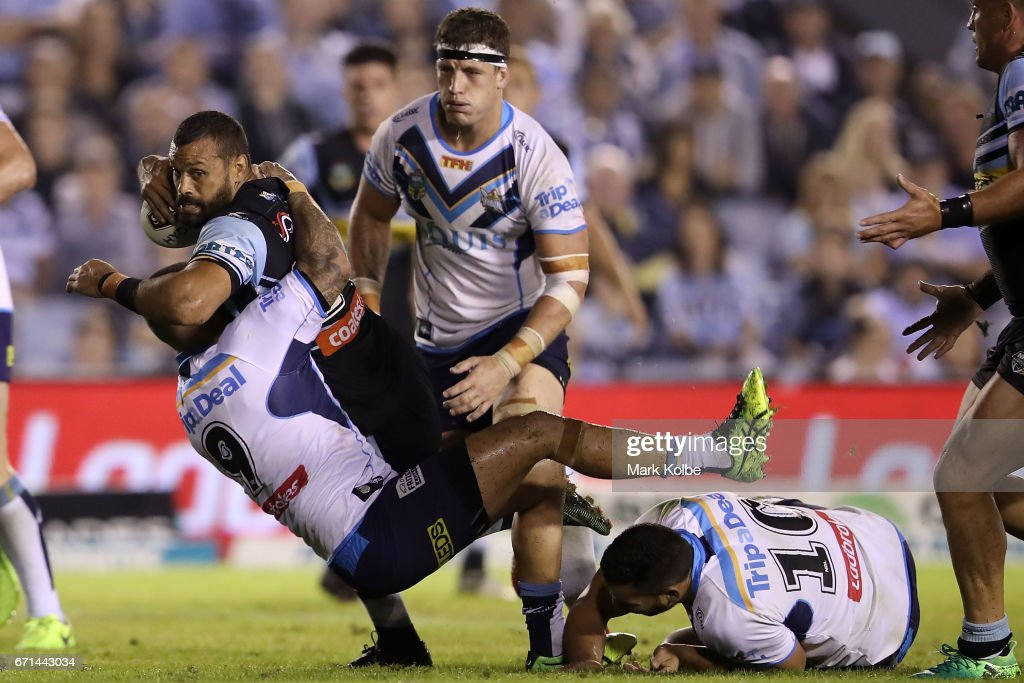 Jayson Bukuya of the Sharks is tackled by Nathan Peats, Jarrod Wallace and Ryan James of the Titans during the round eight NRL match between the Cronulla Sharks and the Gold Coast Titans at Southern Cross Group Stadium on April 22, 2017 in Sydney, Australia.