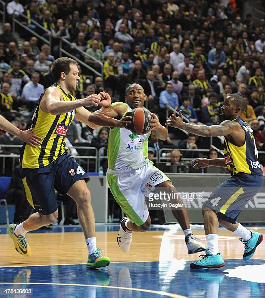 Jayson Granger 15 of Unicaja Malaga competes with Bo McCalebb #4 of Fenerbahce Ulker Istanbul and Bojan Bogdanovic #44 of Fenerbahce Ulker Istanbul...